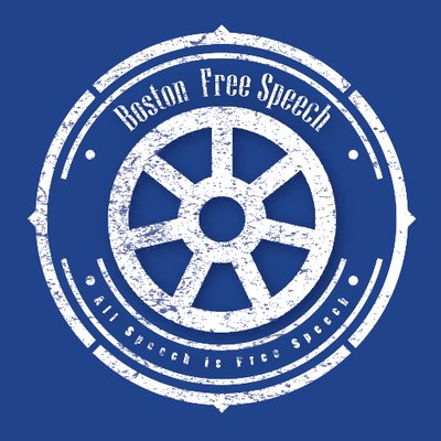 "White logo on blue background. Text reading ""Boston Free Speech, All Speech is Free Speech"" is ringed around to concentric circles connected by seven spokes. Addional cicular designs are aroudn the text. The image is made to look weathered like paint."