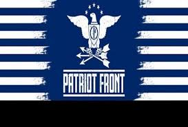 "Image of an eagle with wings outstretched clutching arrows similar to images used by the US government above the text ""Patriot Front."" Eagle has a shield with a fasces, a bundle of sticks around an axe, on its chest. Blue background of the image transitions into blue stripes on the side of the image."